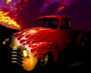Flaming Chevy Pickup Outshines Sunset